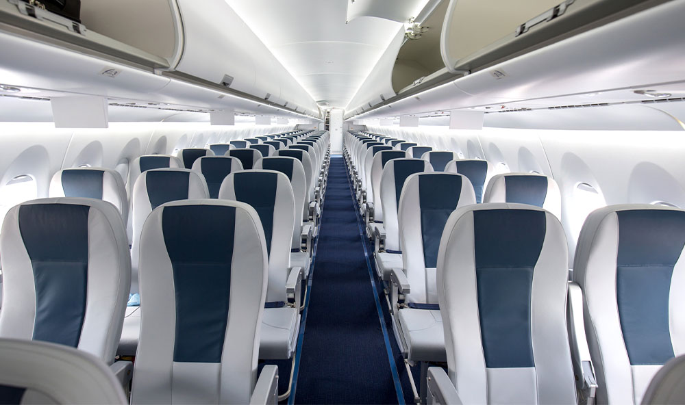 Interior view of a passenger aircraft seats with blue and grey decor